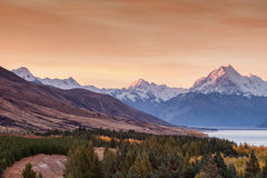 Mt. Cook. Mount Cook towering over glacial Lake Pukaki in hues of turquoise during the sunset Stock Photo