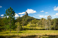 Mt Coonowrin in Queensland Australia. A landscape view of Mt Coonowrin. This extinct volcanic mountain is one of the Glass House mountains located in Queensland royalty free stock photos