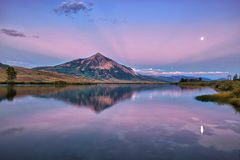 MT Crested Butte in fall season of Colorado, USA. MT Crested Butte with reflection during blue hour in fall season of Colorado, USA stock photos