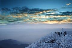 Mt. de sneeuw en de zonsopgang van Emei Stock Foto's