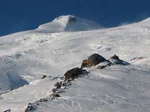 Mt Elbrus and Refuge. Highest in Europe peak of Elbrus mountain and refuge of 11 climbers. 5642 meters. Caucasia, Russia Royalty Free Stock Images