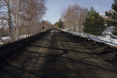 Mt. Etna, volcanic ash in the road. Mount Etna snowy (Sicily Royalty Free Stock Image