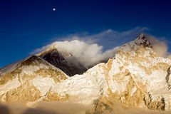 MT Everest & Nuptse at Sunset. Mt Everest and Nuptse at sunset from Kala Patthar, with the moon rising above Everest Stock Photo