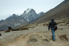 On the Mt Everest Trek. Trekkers and porter go up to Everest base camp, close to Gorak Shep place Stock Photo