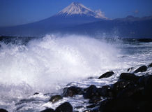 Mt fuji-312. Waves breaking on the coast of Izu with Mt. Fuji in the background Stock Photo