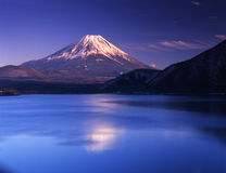 Mt fuji-396. Winter view of Mount Fuji with mist and reflections in a lake Stock Photography