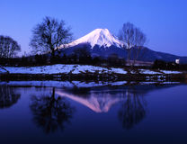 Mt fuji-431. Winter view of Mount Fuji with mist and reflections in a lake Stock Photo