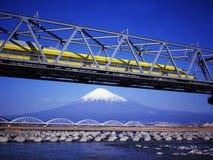 Mt fuji-446. The Shinkansen Yellow docter runs over Mt,Fuji peak Stock Photos