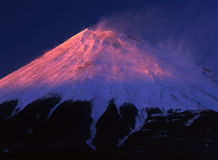 Mt fuji. Evening sun illuminating the peak of Mount Fuji on a clear Winter's Stock Photography