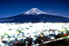 Mt. Fuji with Bokeh at night in Fujiyoshida, Japan.  Royalty Free Stock Photography