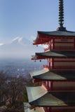 Mt. Fuji with Chureito Pagoda in dry winter, Fujiyoshida, Japan. Mount Fuji and Chureito Pagoda, Japan in winter Stock Photo