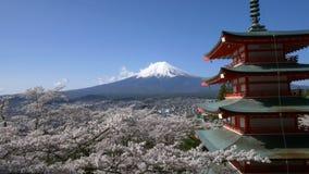 Mt. Fuji with Chureito Pagoda in Spring, Fujiyoshida, Japan stock video footage