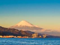 Mt. Fuji from Shizuoka, Japan. Mt. Fuji on Dream Ferry Mini Cruise traveling from Hamanako Lake, Shizuoka, Japan with sunset sky, seagull bird flying and royalty free stock photography