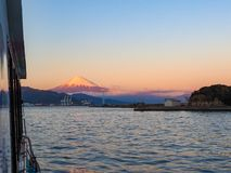 Mt. Fuji from Shizuoka, Japan. Mt. Fuji on Dream Ferry Mini Cruise traveling from Hamanako Lake, Shizuoka, Japan with sunset sky, seagull bird flying and royalty free stock photo