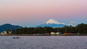 Mt. Fuji from Shizuoka, Japan. Mt. Fuji on Dream Ferry Mini Cruise traveling from Hamanako Lake, Shizuoka, Japan with sunset sky, seagull bird flying and stock image
