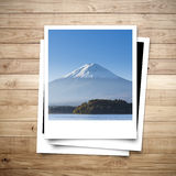 Mt. Fuji Japan memory on photo frame brown wood plank background Stock Images