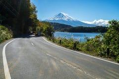 Mt Fuji in Japan and road at Lake Kawaguchiko stock images