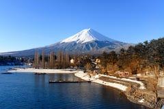 Mt.Fuji and Kawaguchiko Lake. Mt.Fuji is behind Kawaguchiko Lake covered by snow Stock Photo