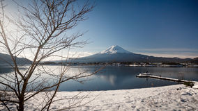 """Mt. Fuji with Kawaguchiko lake. Japan's Mt. Fuji is an active volcano about 100 kilometers southwest of Tokyo. Commonly called """"Fuji-san,"""" it's the Royalty Free Stock Images"""