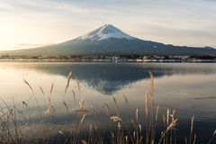 """Mt. Fuji with Kawaguchiko lake. Japan's Mt. Fuji is an active volcano about 100 kilometers southwest of Tokyo. Commonly called """"Fuji-san,"""" it's the Stock Photography"""