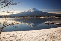 """Mt. Fuji with Kawaguchiko lake. Japan's Mt. Fuji is an active volcano about 100 kilometers southwest of Tokyo. Commonly called """"Fuji-san,"""" it's the Stock Photos"""