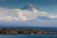 Mt.Fuji and Lake Motosuko. Mt.Fuji was covered with cloud  view from Lake Motosuko Royalty Free Stock Photography