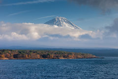 Mt.Fuji and Lake Motosuko. Mt.Fuji was covered with cloud  view from Lake Motosuko Royalty Free Stock Photo