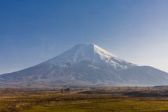 Mt. Fuji  with meadow views. Royalty Free Stock Image