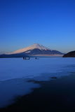 Mt. Fuji over freeze up Lake Yamanaka. Mt. Fuji in the early winter morning Stock Photo