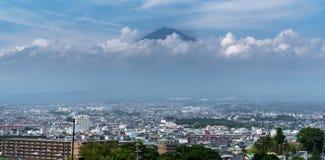 Mt.Fuji over Fujinomiya, Shizuoka, Japan. Wide view of Mt.Fuji and clouds over Fujinomiya, Shizuoka, Japan Stock Photo