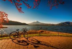 Mt. Fuji over Lake Kawaguchiko with bicycle and autumn foliage a stock photo