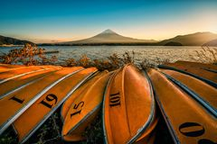 Mt. Fuji over Lake Kawaguchiko with boats at sunset in Fujikawaguchiko, Japan. stock image
