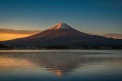 Mt. Fuji over Lake Kawaguchiko at sunrise in Fujikawaguchiko, Japan. stock photos