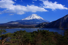 Mt. Fuji over Lake Motosu. This photo is taken in the early spring Stock Photos