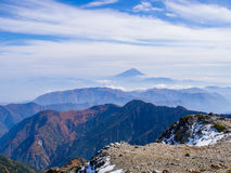 Mt.Fuji over the mist and the mountain ridge Royalty Free Stock Image