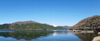 Mt Fuji Panorama. A panoramic view of Mt Fuhi across Lake Ashi stock image