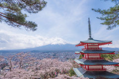 The Mt.Fuji in a part cloudy day with cheery blossom or Sakura. The landscape is also took with others Japanese landmark Stock Photos