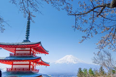 Mt. Fuji with red pagoda in autumn, Fujiyoshida, Japan. With sakura Stock Photos