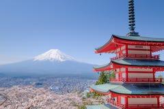 Mt. Fuji with red pagoda in autumn, Fujiyoshida, Japan. With sakura Stock Image