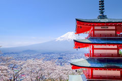 Mt. Fuji with red pagoda in autumn, Fujiyoshida, Japan. With sakura  japan Royalty Free Stock Photo