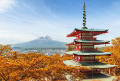 Mt. Fuji with red pagoda at autumn season in Japan Stock Photo