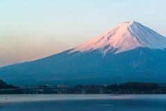 Mt  Fuji rises above Lake Kawaguchi Stock Photos