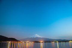 Mt Fuji rises above Lake Kawaguchi. Of Japan stock photography