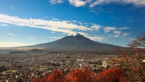 Mt. Fuji rises over Fujiyoshida, Japan. In autumn stock photography