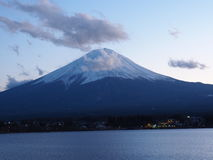 Mt.Fuji san being friend with cloud. royalty free stock photography