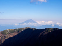 Mt.Fuji scenery at high altitude view benind the mountain ridge Royalty Free Stock Photography