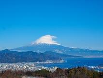Mt. Fuji from Shizuoka, Japan. Mt. Fuji on Dream Ferry Mini Cruise traveling from Hamanako Lake, Shizuoka, Japan with sunset sky, seagull bird flying and stock photography