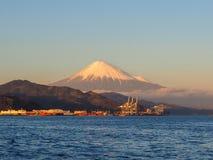 Mt. Fuji from Shizuoka, Japan. Mt. Fuji on Dream Ferry Mini Cruise traveling from Hamanako Lake, Shizuoka, Japan with sunset sky, seagull bird flying and stock photos