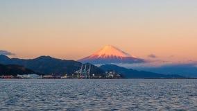 Mt. Fuji from Shizuoka, Japan. Mt. Fuji on Dream Ferry Mini Cruise traveling from Hamanako Lake, Shizuoka, Japan with sunset sky, seagull bird flying and royalty free stock image