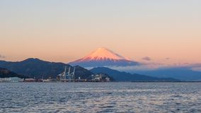 Mt. Fuji from Shizuoka, Japan. Mt. Fuji on Dream Ferry Mini Cruise traveling from Hamanako Lake, Shizuoka, Japan with sunset sky, seagull bird flying and stock photo